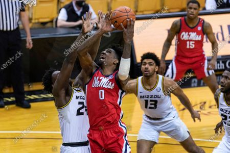 Mississippi's Romello White (0) is fouled by Missouri's Kobe Brown, left, as White shoots in front of Mark Smith, right, during the first half of an NCAA college basketball game, in Columbia, Mo