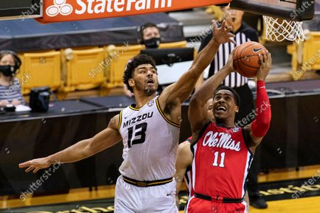 Mississippi's Matthew Murrell, right, shoots past Missouri's Mark Smith during the first half of an NCAA college basketball game, in Columbia, Mo