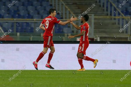 Robert Lewandowski of Bayern München celebrates with teammate Kingsley Coman after scoring a goal during the UEFA Champions League Round of 16 match between Lazio Roma and Bayern München at Olimpico Stadium on February 23, 2021 in Rome, Italy. Bayern München won the match 4-1.