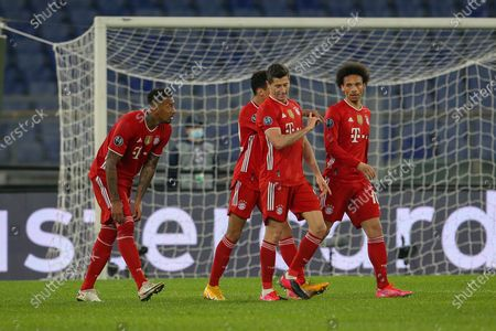 Robert Lewandowski and Leroy Sane of Bayern München celebrate after scoring a goal during the UEFA Champions League Round of 16 match between Lazio Roma and Bayern München at Olimpico Stadium on February 23, 2021 in Rome, Italy. Bayern München won the match 4-1.