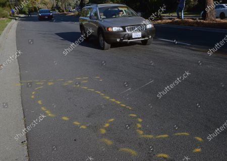 Markings on the pavement of Hawthorne Blvd. as part of the police investigation of golf legend Tiger Woods' car crash are seen in Rolling Hills Estates, California on Tuesday, February 23, 2021. Woods was involved in a serious car crash Tuesday morning that resulted in significant injuries to both his legs, the Los Angeles County Sheriff's Department said.