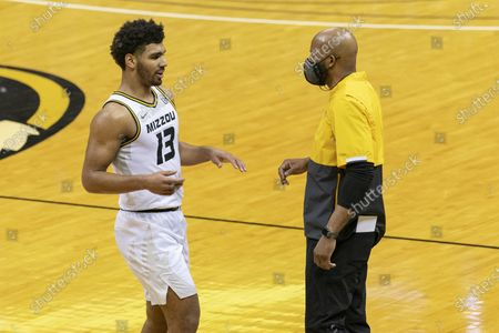 Missouri head coach Cuonzo Martin, right, talks to player Mark Smith, left, during the second half of an NCAA college basketball game against Mississippi, in Columbia, Mo