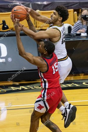 Missouri's Mark Smith, right, battles Mississippi's Luis Rodriguez, left, for a rebound during the second half of an NCAA college basketball game, in Columbia, Mo. Mississippi 60-53