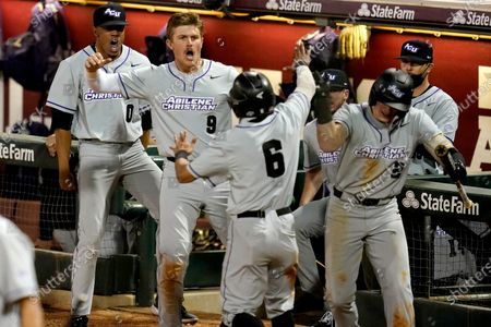 Stock Image of Abilene Christian's Alexei Cazarin (6) reacts with teammates Hunter Gieser (9) and Trevor Jackson (0) after scoring the go ahead run against Texas A&M in the top of the ninth inning during an NCAA baseball game on in College Station, Texas