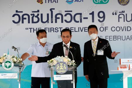 Thai Prime Minister Prayut Chan-o-cha (C), Deputy Prime Minister and Public Health Minister Anutin Charnvirakul (L) and Chinese charge d'affaires Yang Xin (R) gesture during a press conference at Suvarnabhumi Airport Free Zone in Samut Prakan province, Thailand, 24 February 2021. Thailand received a first batch of 200,000 doses of Sinovac vaccine and 117,000 doses of AstraZeneca vaccine as the country is set to kick off its national inoculation program, with the first jab scheduled for medical staff and at-risks groups.