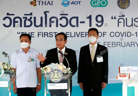 Thai Prime Minister Prayut Chan-o-cha (C) speaks to media next to Deputy Prime Minister and Public Health Minister Anutin Charnvirakul (L) and Chinese charge d'affaires Yang Xin (R) during for the arrival of the first COVID-19 vaccine shipment at Suvarnabhumi Airport Free Zone in Samut Prakan province, Thailand, 24 February 2021. Thailand received a first batch of 200,000 doses of Sinovac vaccine and 117,000 doses of AstraZeneca vaccine as the country is set to kick off its national inoculation program, with the first jab scheduled for medical staff and at-risks groups.