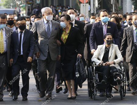 Thai former anti-government protest leader Suthep Thaugsuban (3-L) and Education Minister Nataphol Teepsuwan (R, top) with his wife Taya Teepsuwan (R,bottom) arrive for a hearing at the Criminal Court, in Bangkok, Thailand, 24 February 2021. A Thai court will rule on 24 February in the trial of former anti-government protesters from the People's Democratic Reform Committee including former MP Suthep Thaugsuban, Education Minister Nataphol Teepsuwan, and the Digital Economy and Society Minister Buddhipongse Punnakanta, in connection to street demonstrations against the government of former Prime Minister Yingluck Shinawatra in 2013-14. The charges include insurrection, illegal assembly and obstructing elections.
