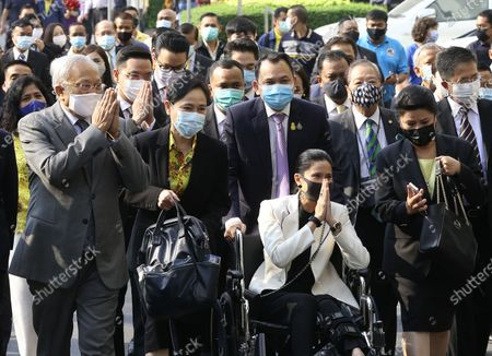 Thai former anti-government protest leader Suthep Thaugsuban (L) and Education Minister Nataphol Teepsuwan (C, top) with his wife Taya Teepsuwan (C,bottom) arrive for a hearing at the Criminal Court, in Bangkok, Thailand, 24 February 2021. A Thai court will rule on 24 February in the trial of former anti-government protesters from the People's Democratic Reform Committee including former MP Suthep Thaugsuban, Education Minister Nataphol Teepsuwan, and the Digital Economy and Society Minister Buddhipongse Punnakanta, in connection to street demonstrations against the government of former Prime Minister Yingluck Shinawatra in 2013-14. The charges include insurrection, illegal assembly and obstructing elections.