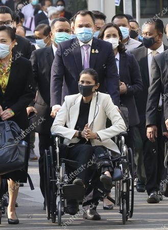Thai Education Minister and a former anti-government protest Nataphol Teepsuwan (C-top) with his wife Taya Teepsuwan (C) arrive for a hearing at the Criminal Court, in Bangkok, Thailand, 24 February 2021. A Thai court will rule on 24 February in the trial of former anti-government protesters from the People's Democratic Reform Committee including former MP Suthep Thaugsuban, Education Minister Nataphol Teepsuwan, and the Digital Economy and Society Minister Buddhipongse Punnakanta, in connection to street demonstrations against the government of former Prime Minister Yingluck Shinawatra in 2013-14. The charges include insurrection, illegal assembly and obstructing elections.