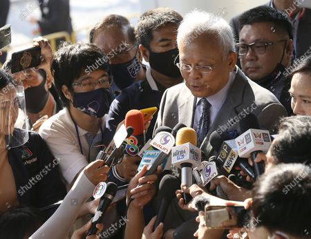 Thai former anti-government protest leader Suthep Thaugsuban (C) speaks to media as he arrives for a hearing at the Criminal Court, in Bangkok, Thailand, 24 February 2021. A Thai court will rule on 24 February in the trial of former anti-government protesters from the People's Democratic Reform Committee, including former MP Suthep Thaugsuban, Education Minister Nataphol Teepsuwan, and the Digital Economy and Society Minister Buddhipongse Punnakanta, in connection to street demonstrations against the government of former Prime Minister Yingluck Shinawatra in 2013-14. The charges include insurrection, illegal assembly and obstructing elections.