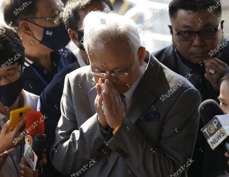 Thai former anti-government protest leader Suthep Thaugsuban (C) greets media as he arrives for a hearing at the Criminal Court, in Bangkok, Thailand, 24 February 2021. A Thai court will rule on 24 February in the trial of former anti-government protesters from the People's Democratic Reform Committee, including former MP Suthep Thaugsuban, Education Minister Nataphol Teepsuwan, and the Digital Economy and Society Minister Buddhipongse Punnakanta, in connection to street demonstrations against the government of former Prime Minister Yingluck Shinawatra in 2013-14. The charges include insurrection, illegal assembly and obstructing elections.