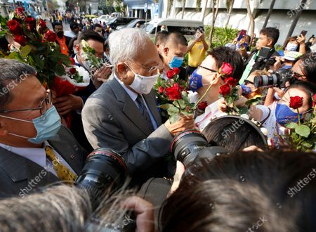 Thai former anti-government protest leader Suthep Thaugsuban (C) receives flowers from supporters as he arrives for a hearing at the Criminal Court, in Bangkok, Thailand, 24 February 2021. A Thai court will rule on 24 February in the trial of former anti-government protesters from the People's Democratic Reform Committee, including former MP Suthep Thaugsuban, Education Minister Nataphol Teepsuwan, and the Digital Economy and Society Minister Buddhipongse Punnakanta, in connection to street demonstrations against the government of former Prime Minister Yingluck Shinawatra in 2013-14. The charges include insurrection, illegal assembly and obstructing elections.