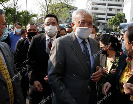 Thai former anti-government protest leader Suthep Thaugsuban (R) walks next the Digital Economy and Society Minister Buddhipongse Punnakanta (L) as they arrive for a hearing at the Criminal Court, in Bangkok, Thailand, 24 February 2021. A Thai court will rule on 24 February in the trial of former anti-government protesters from the People's Democratic Reform Committee, including former MP Suthep Thaugsuban, Education Minister Nataphol Teepsuwan, and the Digital Economy and Society Minister Buddhipongse Punnakanta, in connection to street demonstrations against the government of former Prime Minister Yingluck Shinawatra in 2013-14. The charges include insurrection, illegal assembly and obstructing elections.