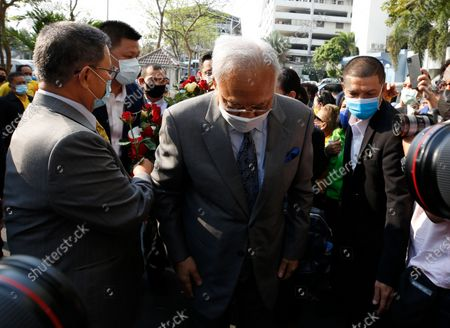Thai former anti-government protest leader Suthep Thaugsuban (C) arrives for a hearing at the Criminal Court, in Bangkok, Thailand, 24 February 2021. A Thai court will rule on 24 February in the trial of former anti-government protesters from the People's Democratic Reform Committee, including former MP Suthep Thaugsuban, Education Minister Nataphol Teepsuwan, and the Digital Economy and Society Minister Buddhipongse Punnakanta, in connection to street demonstrations against the government of former Prime Minister Yingluck Shinawatra in 2013-14. The charges include insurrection, illegal assembly and obstructing elections.