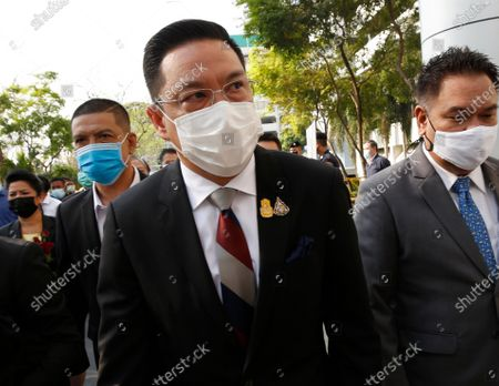 Thai Digital Economy and Society Minister and a former anti-government protest Buddhipongse Punnakanta (C) arrives for a hearing at the Criminal Court, in Bangkok, Thailand, 24 February 2021. A Thai court will rule on 24 February in the trial of former anti-government protesters from the People's Democratic Reform Committee, including former MP Suthep Thaugsuban, Education Minister Nataphol Teepsuwan, and the Digital Economy and Society Minister Buddhipongse Punnakanta, in connection to street demonstrations against the government of former Prime Minister Yingluck Shinawatra in 2013-14. The charges include insurrection, illegal assembly and obstructing elections.