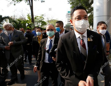 Thai Digital Economy and Society Minister and a former anti-government protest Buddhipongse Punnakanta (R) arrives for a hearing at the Criminal Court, in Bangkok, Thailand, 24 February 2021. A Thai court will rule on 24 February in the trial of former anti-government protesters from the People's Democratic Reform Committee, including former MP Suthep Thaugsuban, Education Minister Nataphol Teepsuwan, and the Digital Economy and Society Minister Buddhipongse Punnakanta, in connection to street demonstrations against the government of former Prime Minister Yingluck Shinawatra in 2013-14. The charges include insurrection, illegal assembly and obstructing elections.