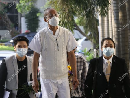Thai former anti-government protest Suwit Thongprasert, also knowns as former Buddhist monk Phra Buddha Isara (C), arrives for a hearing at the Criminal Court, in Bangkok, Thailand, 24 February 2021. A Thai court will rule on 24 February in the trial of former anti-government protesters from the People's Democratic Reform Committee, including former MP Suthep Thaugsuban, Education Minister Nataphol Teepsuwan, and the Digital Economy and Society Minister Buddhipongse Punnakanta, in connection to street demonstrations against the government of former Prime Minister Yingluck Shinawatra in 2013-14. The charges include insurrection, illegal assembly and obstructing elections.