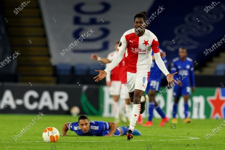 Stock Image of Peter Olayinka of Slavia Prague reacts after he fouls Youri Tielemans of Leicester City; King Power Stadium, Leicester, Midlands, England; UEFA Europa League Football, Knockout Round, Leicester City versus Slavia Prague.