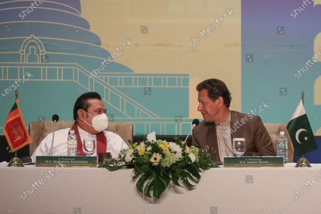 Pakistan's Prime Minister Imran Khan (R) and Sri Lankan Prime Minister Mahinda Rajapaksa (L) chat during the Pakistan-Sri Lanka Trade and Investment Conference in Colombo, Sri Lanka, 24 February 2021. Khan is on a two-day official visit to Sri Lanka.