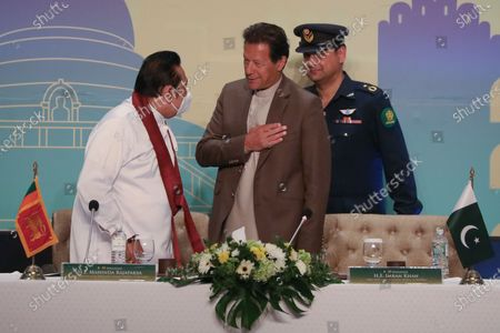 Pakistan's Prime Minister Imran Khan (C) and Sri Lankan Prime Minister Mahinda Rajapaksa (L) greet each other as they attend the Pakistan-Sri Lanka Trade and Investment Conference in Colombo, Sri Lanka, 24 February 2021. Khan is on a two-day official visit to Sri Lanka.