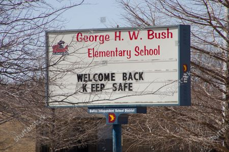 Stock Picture of Photo taken on Feb. 23, 2021 shows the school billboard of George H. W. Bush Elementary School in Dallas, Texas, the United States. Some schools in U.S. state of Texas are closed this week due to the impact of severe winter storm that brought millions without power and water for days.