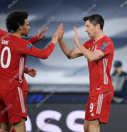 Bayern Munich's Robert Lewandowski (R) celebrates with Leroy Sane during a UEFA Champions League round of 16 first leg football match between Lazio and Bayern Munich in Rome, Italy, Feb. 23, 2021.
