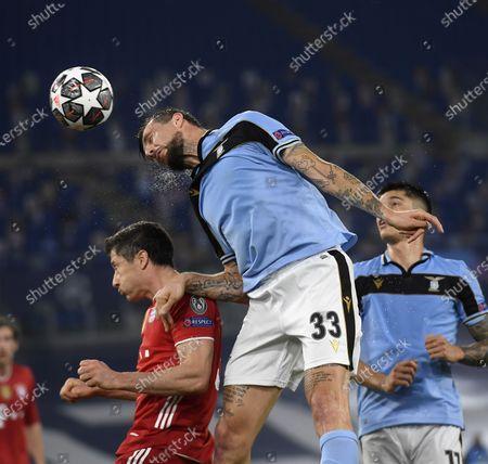 Bayern Munich's Robert Lewandowski (L) vies with Lazio's Francesco Acerbi (C) during a UEFA Champions League round of 16 first leg football match between Lazio and Bayern Munich in Rome, Italy, Feb. 23, 2021.