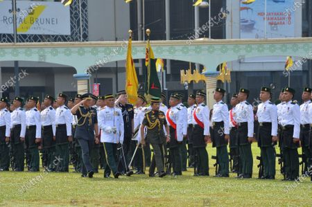 Stock Photo of Brunei's Sultan Haji Hassanal Bolkiah inspects the guard of honor during the country's 37th National Day celebrations in Bandar Seri Begawan, capital of Brunei, on Feb. 23, 2021. Brunei held a parade and performances with about 4,000 participants in the capital on Tuesday to celebrate its 37th National Day. Brunei declared its independence in 1984.