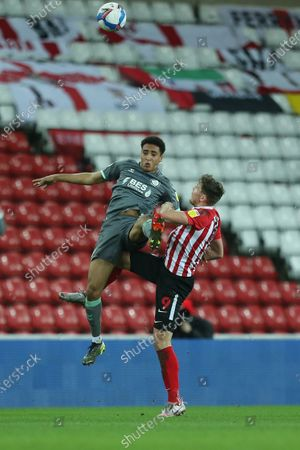 James Hill of Fleetwood Town contests a header with Charlie Wyke of Sunderland during the Sky Bet League 1 match between Sunderland and Fleetwood Town at the Stadium Of Light, Sunderland on Tuesday 23rd February 2021. (Photo by Mark Fletcher/MI News/NurPhoto)