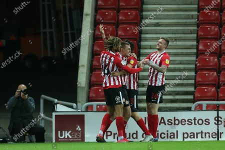 Max Power of Sunderland celebrates with Dion Sanderson, Luke O'Nien and Carl Winchester after scoring their second goal during the Sky Bet League 1 match between Sunderland and Fleetwood Town at the Stadium Of Light, Sunderland on Tuesday 23rd February 2021. (Photo by Mark Fletcher/MI News/NurPhoto)