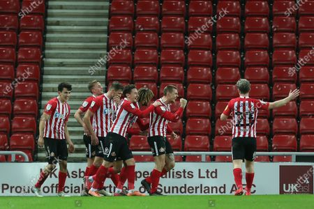 Max Power of Sunderland celebrates with Dion Sanderson, Luke O'Nien, Charlie Wyke and Carl Winchester after scoring their second goal during the Sky Bet League 1 match between Sunderland and Fleetwood Town at the Stadium Of Light, Sunderland on Tuesday 23rd February 2021. (Photo by Mark Fletcher/MI News/NurPhoto)