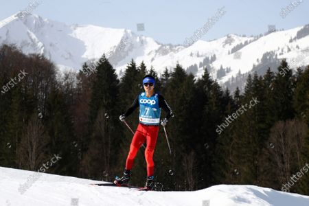 Stock Image of Wei Yan Tang of Malaysia competes during men's the interval start free qualification race for the upcoming FIS Nordic World Ski Championships in Oberstdorf, Germany