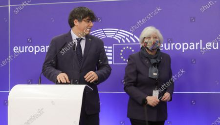Former members of the Catalan government, now members of European Parliament, Carles Puigdemont (L) and Clara Ponstati, attend a news conference on the lift of parliamentary immunity procedure by European Parliament in Brussels, Belgium, 24 February 2021.