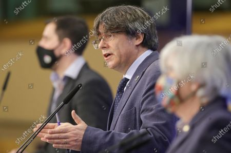 Former members of the Catalan government, now members of European Parliament, Carles Puigdemont (C), Clara Ponstati, and Antoni Comin i Oliveres (L) attend a news conference on the lift of parliamentary immunity procedure by European Parliament in Brussels, Belgium, 24 February 2021.