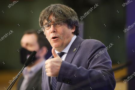 Former members of the Catalan government, now members of European Parliament, Carles Puigdemont and Antoni Comin i Oliveres (L), during a news conference on the lift of parliamentary immunity procedure by European Parliament in Brussels, Belgium, 24 February 2021.