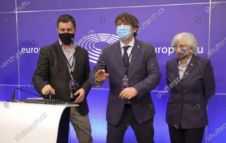 Former members of the Catalan government, now members of European Parliament, Carles Puigdemont (C), Clara Ponstati and Antoni Comin i Oliveres (L), attend a news conference on the lift of parliamentary immunity procedure by European Parliament in Brussels, Belgium, 24 February 2021.