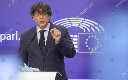 Former member of the Catalan government, now member of European Parliament, Carles Puigdemont speaks during a news conference on the lift of parliamentary immunity procedure by European Parliament in Brussels, Belgium, 24 February 2021.