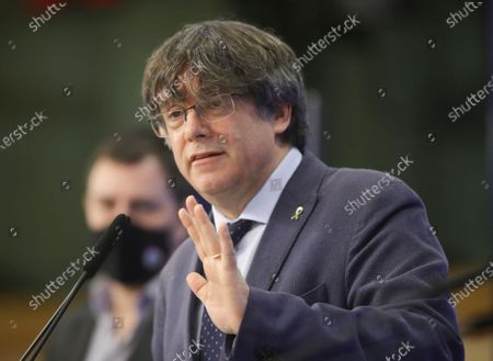 Former members of the Catalan government, now members of European Parliament Carles Puigdemont and Antoni Comin i Oliveres (L) attend a news conference on the lift of parliamentary immunity procedure by European Parliament in Brussels, Belgium, 24 February 2021.