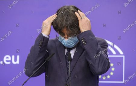 Former member of the Catalan government, now member of European Parliament Carles Puigdemont gestures during a news conference on the lift of parliamentary immunity procedure by European Parliament in Brussels, Belgium, 24 February 2021.