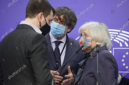 Stock Picture of Former members of the Catalan government, now members of European Parliament Carles Puigdemont (C), Clara Ponstati (R) and Antoni Comin i Oliveres attend a news conference on the lift of immunity procedure by European Parliament in Brussels, Belgium, 24 February 2021.