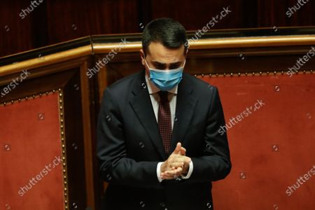 Italian Foreign Minister Luigi di Maio wears a face mask to curb the spread of COVID-19 as he addresses the Senate on Monday's killing in the Democratic Republic of Congo of the Italian ambassador Luca Attanasio, an Italian Carabinieri police officer and their Congolese driver, in Rome, . Di Maio told lawmakers in Rome that Italy has asked both the United Nations and the U.N. World Food Program to open an investigation into the security arrangements for the U.N. food aid convoy in Congo which they were traveling in