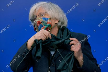Former Catalan education minister Clara Ponsati prepares to address a media conference at the European Parliament in Brussels, . A key European Parliament committee voted Tuesday to lift the immunity of three former top Catalan officials who fled Spain fearing arrest over a secessionist push they led in the region, possibly paving the way for their extradition