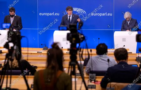 Former Catalan leader Carles Puigdemont, center, speaks during a media conference at the European Parliament in Brussels, . A key European Parliament committee voted Tuesday to lift the immunity of three former top Catalan officials who fled Spain fearing arrest over a secessionist push they led in the region, possibly paving the way for their extradition. At right is former education minister Clara Ponsati and left is former health minister Toni Comin