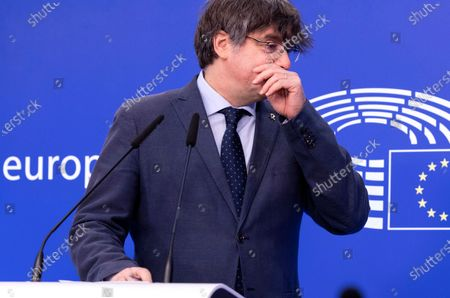 Stock Image of Former Catalan leader Carles Puigdemont speaks during a media conference at the European Parliament in Brussels, . A key European Parliament committee voted Tuesday to lift the immunity of three former top Catalan officials who fled Spain fearing arrest over a secessionist push they led in the region, possibly paving the way for their extradition
