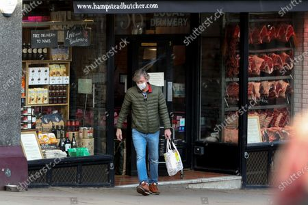Stock Picture of Exclusive - Richard Madeley going to a butchers on Hampstead High Street