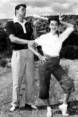 ROCK HUDSON AND BARBARA RUSH DURING THE FILMING OF THE SPIRAL READ