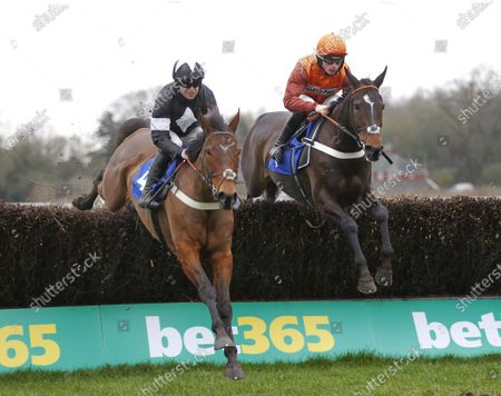 Lust For Glory and James Bowen [right] jump with Liberty Bella and Robert Dunne before victory in the EBF Mares' Novices' Chase at Ludlow.