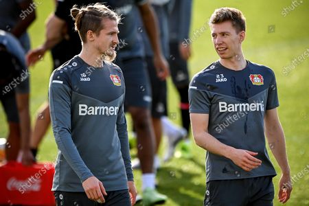 Leverkusen's Tin Jedvaj (L) and Mitchell Weiser (R) attend a training session in Leverkusen, Germany, 24 February 2021. Bayer Leverkusen will face Young Boys Bern in their UEFA Europa League round of 32 second leg soccer match on 25 February 2021.