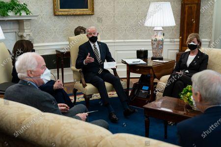 President Joe Biden speaks during a meeting with lawmakers to discuss U.S. supply chains, in the Oval Office of the White House, in Washington, as from left, Vice President Kamala Harris, Senate Minority Whip Sen. John Cornyn, R-Texas, Biden, Sen. Tammy Baldwin, R-Wis., and Sen. Rob Portman, R-Ohio, listen