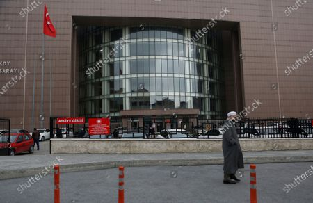 Man walks past the entrance to Istanbul's court, where the case of a Turkish private airline official and two pilots over their involvement in former Nissan Motor Co. chairman Carlos Ghosn's dramatic escape out of Japan in 2019 and to Beirut, Lebanon, was held. The court convicted a Turkish private airline official and two pilots and sentenced them each to four years and two months in prison .Ghosn, who was arrested over financial misconduct allegations in Tokyo in 2018, skipped bail while awaiting trial there